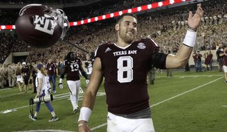 FILE - In this Oct. 8, 2016, file photo, Texas A&M quarterback Trevor Knight (8) tosses his helmet as he celebrates after beating Tennessee in an NCAA college football game, in College Station, Texas. Texas A&M's Trevor Knight is the highest profile graduate transfer in the Southeastern Conference this season, jumping in to fill a major void at quarterback for the 10th-ranked Aggies. (AP Photo/David J. Phillip, File)