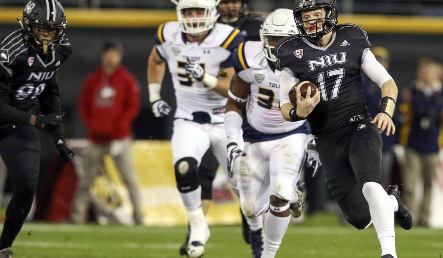 Northern Huskies quarterback Ryan Graham (17) carries the ball against against Toledo Northern Huskies wide receiver Kenny Golladay (19) celebrates with tight end Shane Wimann (35) after scoring a touchdown against Toledo during an NCAA college football game, Wednesday, Nov. 9, 2016, at Guaranteed Rate Field in Chicago. (Sean King/Daily Chronicle via AP)