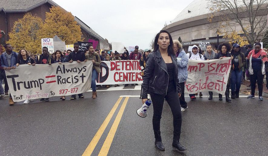 Joseline Tlacomulco leads several hundred people in a march on the University of Connecticut campus, Wednesday, Nov. 9, 2016, in Storrs, Conn., protesting the election of Donald Trump as president. Tlacomula, a sophomore who lives in New Haven, said she was born in Mexico and came with her family to Connecticut when she was 8-months old. She fears her family may face deportation under a Trump administration. (AP Photo/Pat Eaton-Robb)