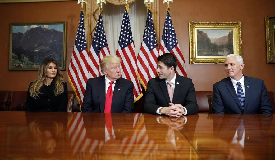 President-elect Donald Trump, his wife Melania and Vice president-elect Mike Pence, talk as they pose for photographers with House Speaker Paul Ryan of Wis. after a meeting in the Speaker's office on Capitol Hill in Washington, Thursday, Nov. 10, 2016. (AP Photo/Alex Brandon)
