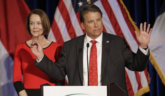 North Carolina Gov. Pat McCrory speaks to supporters as his wife Ann McCrory listens at an election rally in Raleigh, N.C., Wednesday, Nov. 9, 2016. (AP Photo/Chuck Burton) ** FILE **