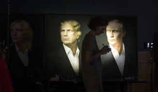 Portraits of President-elect Donald Trump and Russian President Vladimir Putin hang in the Union Jack pub in Moscow. (Associated Press/File)