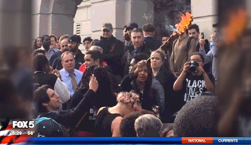Students at American University in Washington, D.C., burned the American flag on Wednesday, Nov. 9, 2016, in response to Donald Trump's election victory over Hillary Clinton. (Fox 5 screenshot) ** FILE **