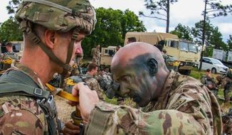 An officer has his gear inspected during the Little Group of Paratroopers event during All American Week 2016, Fort Bragg, N.C. May 23. (Facebook, 82nd Airborne Division)