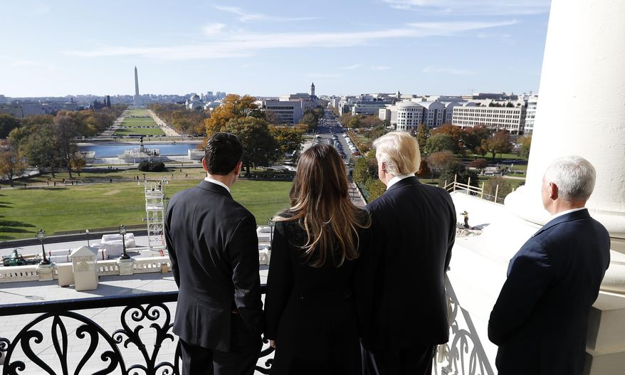 House Speaker Paul Ryan of Wis., left, shows President-elect Donald Trump, his wife Melania and Vice president-elect Mike Pence the view of the inaugural stand that is being built and Pennsylvania Avenue, from the Speaker's Balcony on Capitol Hill in Washington, Thursday, Nov. 10, 2016. (AP Photo/Alex Brandon)