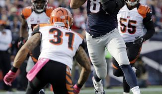FILE - in this Oct. 16, 2016, file photo, New England Patriots tight end Rob Gronkowski (87) catches a pass between Cincinnati Bengals safety Derron Smith (31) and linebacker Vontaze Burfict (55) during anNFL football game in Foxborough, Mass. The Patriots play the Seattle Seahawks this week. (AP Photo/Elise Amendola, File)