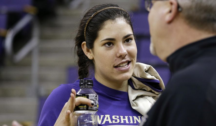 FILE - In this March 29, 2016, file photo, Washington's Kelsey Plum talks with head coach Mike Neighbors before a basketball practice in Seattle. Plum was always going to return to Washington for her senior season, after getting the Huskies to the Final Four. But that didn't stop her from having a little fun and putting a little worry into the mind of Neighbors. (AP Photo/Elaine Thompson, File)