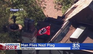 Frederick Roeber, who lives in San Francisco's Dolores Heights, prominently displayed a Nazi flag on Nov. 9, 2016, to protest Donald Trump's presidential victory. (KPIX)