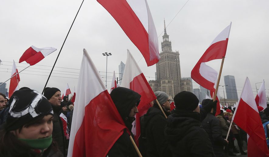In this file photo, nationalists, carrying Polish flags, march in large numbers through the streets of Warsaw to mark Poland's Independence Day in Warsaw, Poland, Friday, Nov. 11, 2016. (AP Photo/Czarek Sokolowski) **FILE**