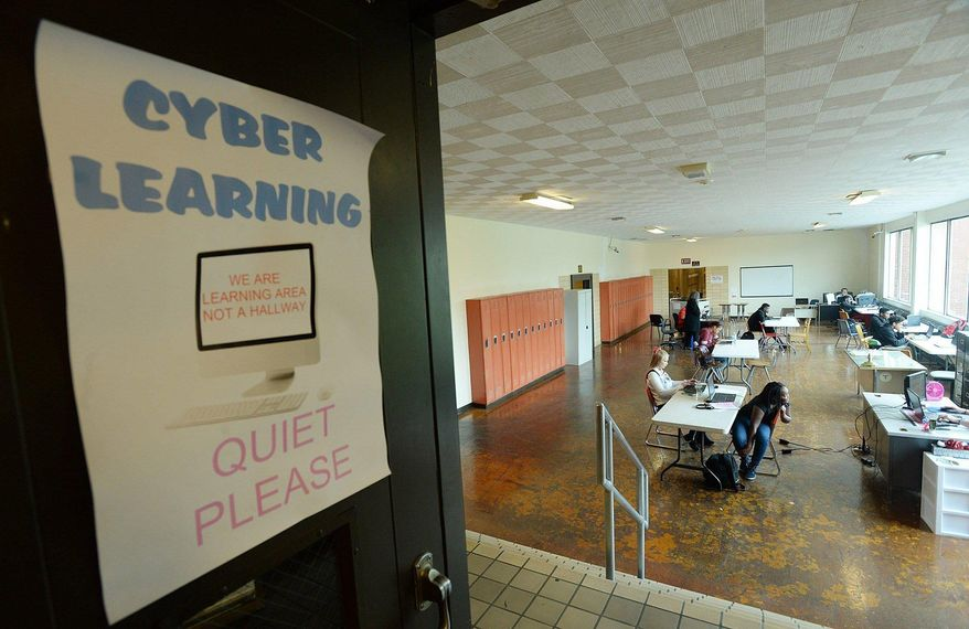 ADVANCE FOR USE SATURDAY, NOV. 12 - In this Nov. 2, 2016 photo, cyber students attend class  at Central Career and Technical School in Erie, Pa. (Jack Hanrahan/Erie Times-News via AP)