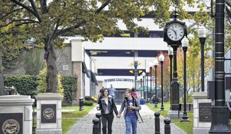 In this Oct. 17, 2016 photo, Wilkes University students walk through the campus in Wilkes-Barre, Pa. Higher education officials and local leaders in Wilkes-Barre, Pa., say the city has already been reinvented as a college town or is on its way to becoming one, spurred by the opening of a joint college bookstore, downtown movie theater, eateries and bars that lure students from downtown campuses. (Aimee Dilger/The Times Leader via AP)