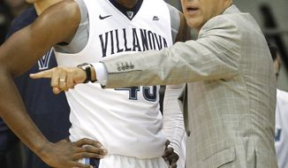 Villanova head coach Jay Wright, right, talks with Darryl Reynolds (45) in the first half of an NCAA college basketball game against Lafayette, Friday, Nov. 11, 2016, in Villanova. (AP Photo/Laurence Kesterson)