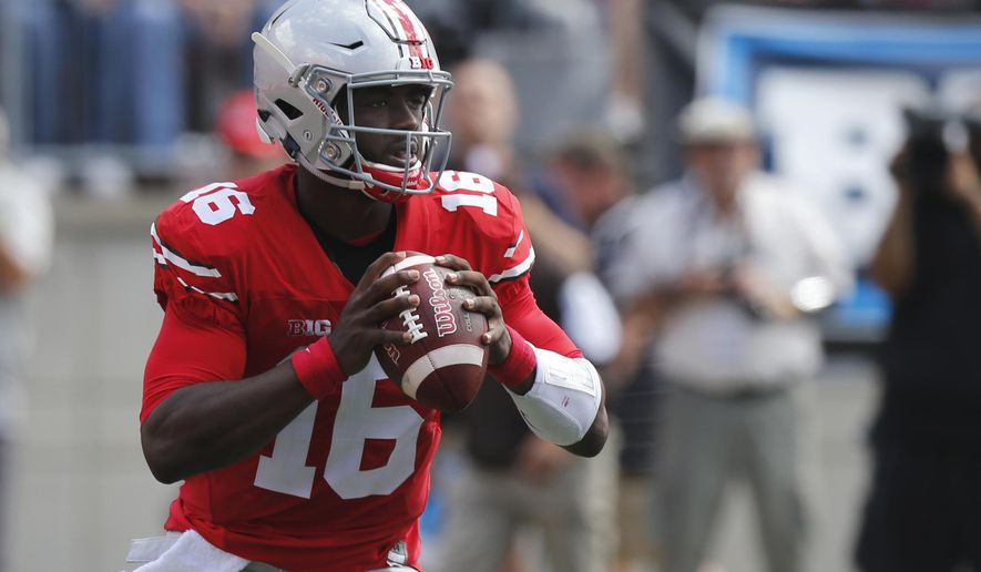 FILE - In this Sept. 3, 2016, file photo, Ohio State quarterback J.T. Barrett plays against Bowling Green during an NCAA college football game, in Columbus, Ohio. Maryland faces Ohio State on Saturday. The Terrapins have lost four of five, including a 59-3 humiliation at Michigan. Throw in the 101 points that Ohio State has scored in its last two games against Maryland, and this shapes up to be a huge mismatch.  (AP Photo/Jay LaPrete, File)
