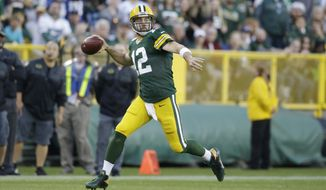 FILE - In this Nov. 6, 2016, file photo, Green Bay Packers' Aaron Rodgers throws during the first half of an NFL football game against the Indianapolis Colts, in Green Bay, Wis. A two-game skid has whittled away any margin for error the Packers had in the NFC North, and now they hit the road for three straight games starting in Tennessee. (AP Photo/Jeffrey Phelps, File)