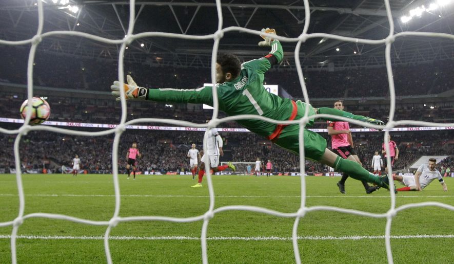 England's Adam Lallana, right, falling, scores his side's second goal passing Scotland's goalkeeper Craig Gordon during the World Cup group F qualifying soccer match between England and Scotland at the Wembley stadium, London, Friday, Nov. 11, 2016. (AP Photo/Matt Dunham)