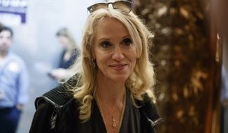 Kellyanne Conway, campaign manager and senior advisor to President-elect Donald Trump, talks with reporters as she arrives at Trump Tower, Saturday, Nov. 12, 2016, in New York. (AP Photo/ Evan Vucci)