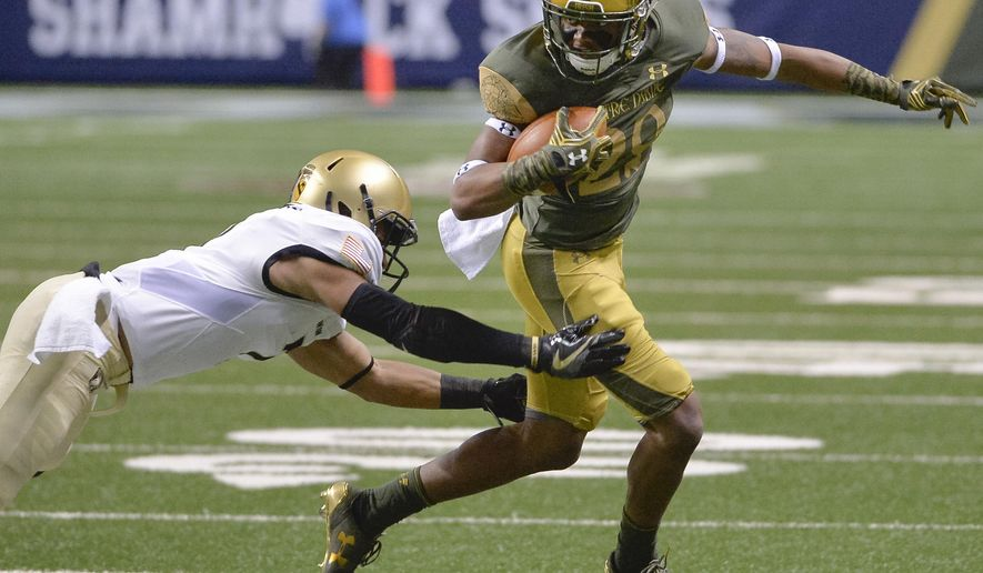 Notre Dame wide receiver Kevin Stepherson, right, evades Army defensive back Jaylon McClinton during the first half of an NCAA college football game, Saturday, Nov. 12, 2016, in San Antonio. (AP Photo/Darren Abate)