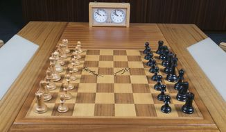 """This undated photo provided by Heritage Auctions shows the chess board used by American Bobby Fischer and Soviet champ Boris Spassky during their historic 1972 """"Match of the Century,"""" a tournament that sealed Fischer's fate as the world chess champion. The board, used in games 7 through 21 at the Reykjavik, Iceland, championship is slated to be auctioned in New York City on Nov. 18 by Heritage Auctions, which has set an opening bid of $75,000. (Heritage Auctions via AP)"""