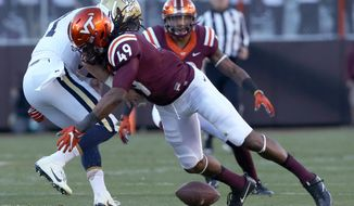 Georgia Tech quarterback Matthew Jordan (11) fumbles while being hit by Virginia Tech defender Tremaine Edmunds (49) during the first half of an NCAA football game in Blacksburg, Va., Saturday, Nov. 12 2016. (Matt Gentry/The Roanoke Times via AP) ** FILE **
