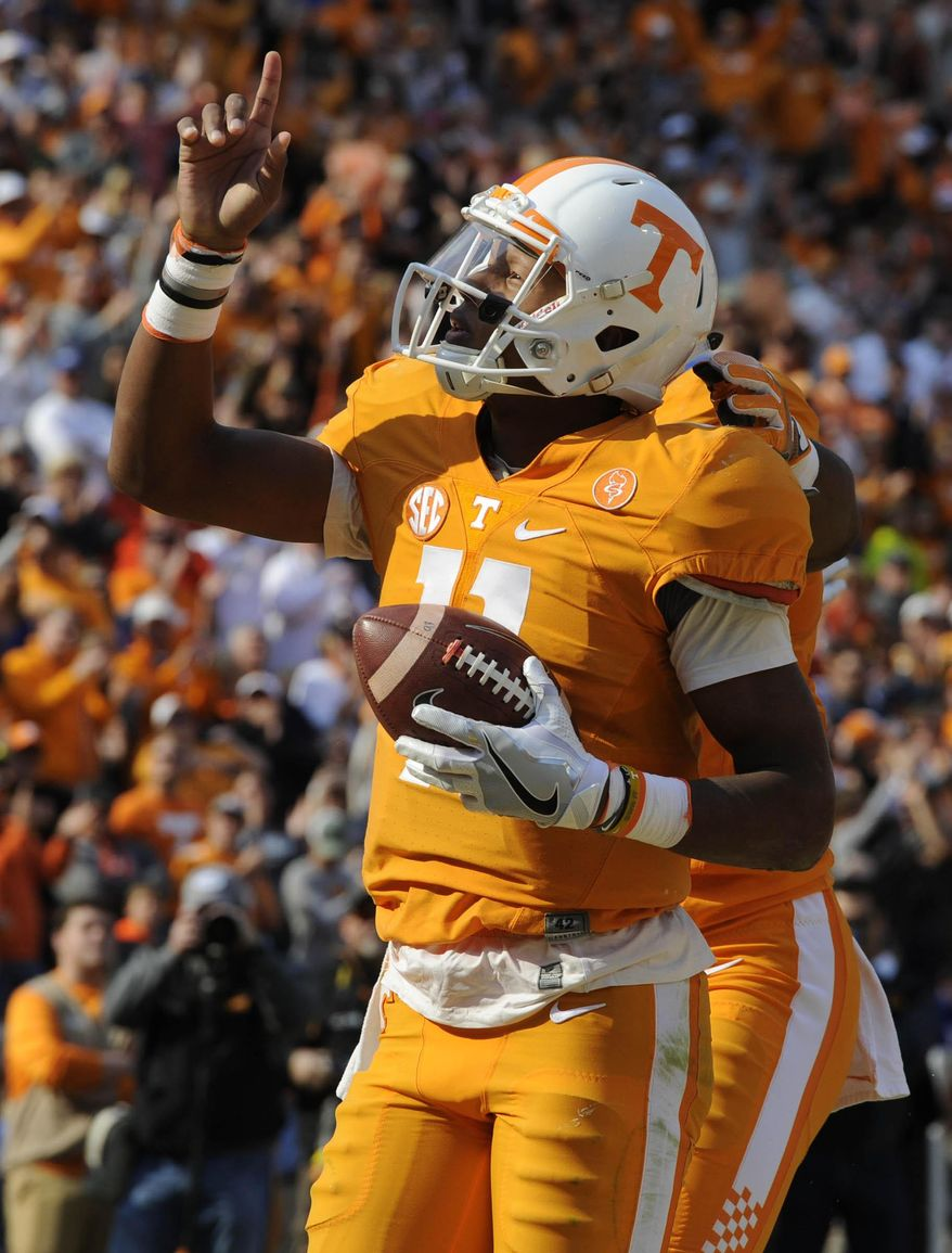 Tennessee quarterback Joshua Dobbs (11) celebrates a one-yard run for a touchdown against Kentucky during the first half of an NCAA college football game at Neyland Stadium on Saturday, Nov. 12, 2016, in Knoxville, Tenn. (Saul Young/Knoxville News Sentinel via AP)