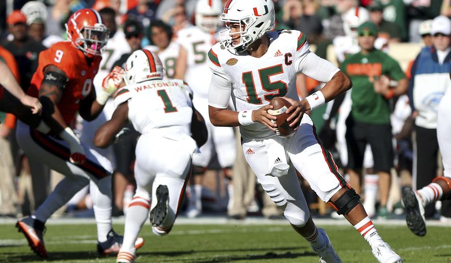 Miami quarterback Brad Kaaya (15) scrambles during the first half of an NCAA college football game in Charlottesville, Va. on Saturday, Nov. 12, 2016. Miami defeated Virginia 34-14. (Ryan M. Kelly/The Daily Progress via AP)