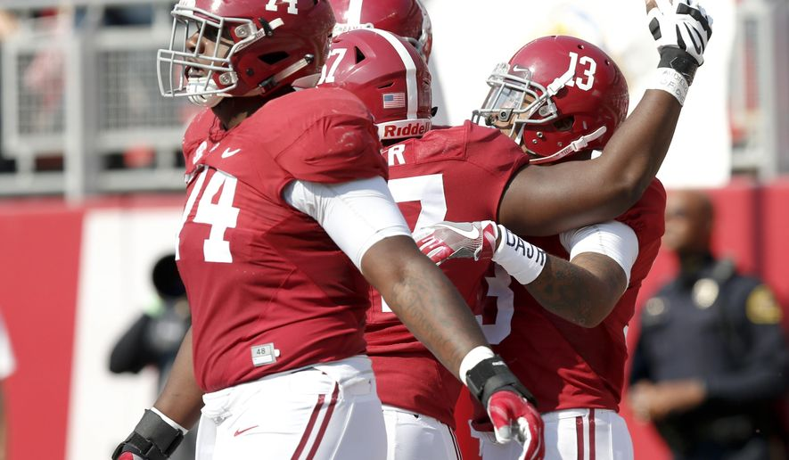 Alabama wide receiver ArDarius Stewart (13) celebrates with teammates after scoring a touchdown against Mississippi State during the first half of an NCAA college football game, Saturday, Nov. 12, 2016, in Tuscaloosa, Ala. (AP Photo/Brynn Anderson)