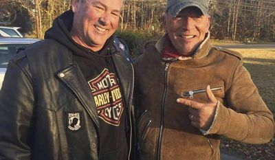 In this Friday, Nov. 11, 2016, photo provided by Ryan Bailey, Dan Barkalow, left, and Bruce Springsteen poses for a photo in Wall Township, N.J. Barkalow and a group from the Freehold American Legion was riding after a Veterans Day event Friday when they pulled over to help a stranded motorcyclist who turned out to be The Boss. (Ryan Bailey via AP)