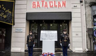 In this file photo, a commemorative plaque unveiled by French President Francois Hollande and Paris Mayor Anne Hidalgo is seen in front of the Bataclan concert hall in Paris, France, during a ceremony held for the victims of 2015's Paris attacks which targeted the Bataclan concert hall as well as a series of bars and killed 130 people, Sunday, Nov. 13, 2016. (Christophe Petit Tesson/Pool Photo via AP) **FILE**
