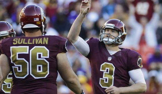 Washington Redskins place kicker Dustin Hopkins (3) points skyward after scoring a field goal during the second half of an NFL football game against the Minnesota Vikings in Landover, Md., Sunday, Nov. 13, 2016. (AP Photo/Patrick Semansky) ** FILE **
