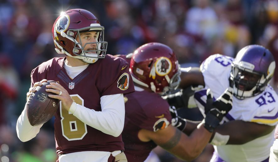 Washington Redskins quarterback Kirk Cousins (8) passes the ball during the first half of an NFL football game against the Minnesota Vikings in Landover, Md., Sunday, Nov. 13, 2016. (AP Photo/Mark Tenally)