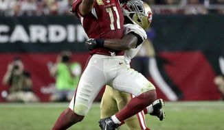 Arizona Cardinals wide receiver Larry Fitzgerald (11) makes a catch as San Francisco 49ers cornerback Jimmie Ward (25) defends during the second half of an NFL football game, Sunday, Nov. 13, 2016, in Glendale, Ariz. (AP Photo/Rick Scuteri)