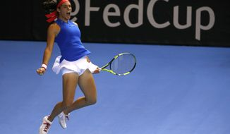 France's Caroline Garcia jumps as she defeats Czech Republic's Karolina Pliskova during the Fed Cup final in Strasbourg, eastern France, Sunday, Nov. 13, 2016. Garcia gave France a 2-1 lead in the Fed Cup final with a 6-3, 3-6, 6-3 win over Pliskova. (AP Photo/Jean-Francois Badias)