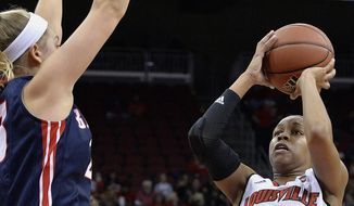 Louisville guard Asia Durr (25) shoots over the defense of Belmont's Kylee Smith (23) during the first half of an NCAA college basketball game Sunday, Nov. 13, 2016, in Louisville, Ky. Louisville won 73-50. (AP Photo/Timothy D. Easley)
