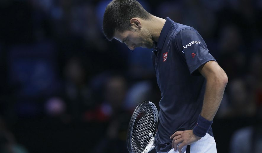 Serbia's Novak Djokovic looks dejected after losing a point to Austria's Dominic Thiem during their ATP World Tour Finals tennis match at the O2 Arena in London, Sunday Nov. 13, 2016. (AP Photo/Tim Ireland)