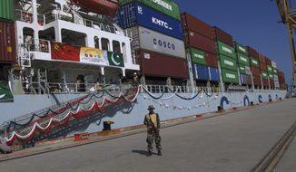 A Pakistan Navy soldier stands guard while a loaded Chinese ship prepares to depart, at Gwadar port, about 700 kilometers (435 miles) west of Karachi. Pakistan, Sunday, Nov. 13, 2016. Pakistan's top civil and military leaders opened a new international trade route by seeing off a Chinese ship that's exporting goods to the Middle East and Africa from the newly built Gwadar port in the country's low-insurgency wracked Baluchistan province. (AP Photo/Muhammad Yousuf)