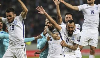 Greece's players celebrate a goal against Bosnia during their World Cup Group H qualifying soccer match at Georgios Karaiskakis Stadium, in Piraeus port, near Athens, on Sunday, Nov. 13, 2016. (AP Photo/Yorgos Karahalis)