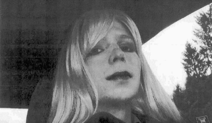 In this undated file photo provided by the U.S. Army, Pfc. Chelsea Manning poses for a photo wearing a wig and lipstick. Manning, a transgender soldier now serving 35 years at the Fort Leavenworth, Kansas military prison for leaking classified information to WikiLeaks, is asking President Barack Obama to commute her sentence to the 6 1/2 years she has already served. (U.S. Army via AP, File)