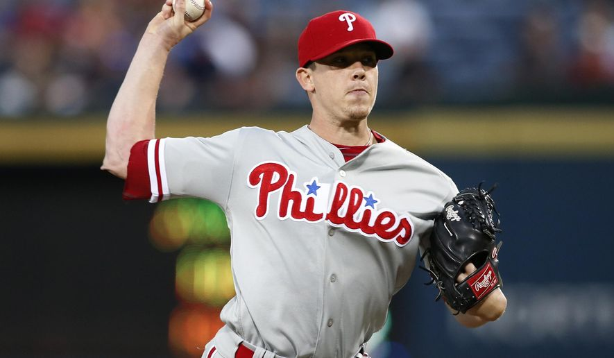FILE This Sept. 29, 2016 file photo shows Philadelphia Phillies starting pitcher Jeremy Hellickson working during the first inning of a baseball game against the Atlanta Braves in Atlanta. Hellickson has accepted a $17.2 million qualifying offer, Monday, Nov. 14, 2016 giving up free agency to stay with his team. (AP Photo/Brett Davis, file)