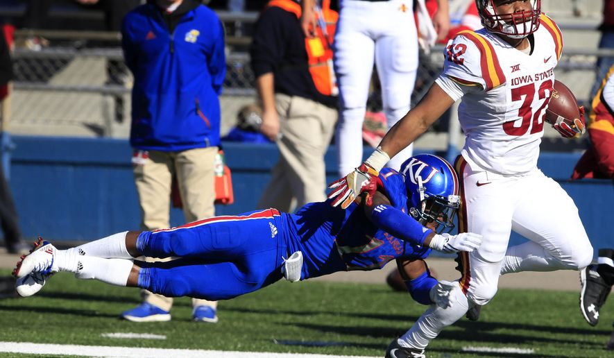 Iowa State running back David Montgomery (32) is tackled after a 46-yard gain by Kansas linebacker Mike Lee (11) during the second half of an NCAA college football game in Lawrence, Kan., Saturday, Nov. 12, 2016. Iowa State defeated Kansas 31-24. (AP Photo/Orlin Wagner)