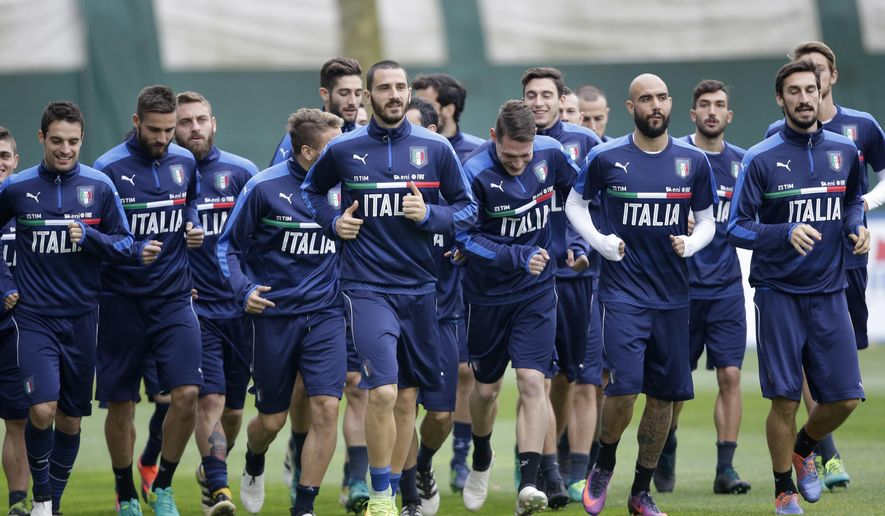 Italian players warm up during a training session in Milan, Italy, Monday, Nov. 14, 2016 ahead of the friendly soccer match between Italy and Germany scheduled for Tuesday, Nov. 15, 2016. (AP Photo/ Luca Bruno)