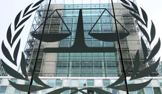 FILE- This Jan. 12, 2016, file photo shows the exterior view of the headquarters of the International Criminal Court in The Hague, Netherlands. U.S. armed forces and the CIA may have committed war crimes by torturing detainees in Afghanistan, the International Criminal Court's chief prosecutor said in a report Monday, Nov. 14, 2016, raising the possibility that American citizens could be indicted even though Washington has not joined the global court. (AP Photo/Mike Corder, File)