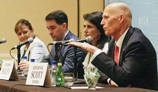 From left: New Mexico's Susana Martinez, Wisconsin's Gov. Scott Walker, South Carolina's Gov. Nikki Haley and Florida's Rick Scott speak at the Republican Governors Association's annual conference this week in Orlando, Florida. (Associated Press)
