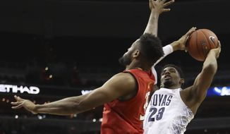 Georgetown's Rodney Pryor (23) shoots against Maryland Terrapins forward Damonte Dodd (35), during the second half of an NCAA college basketball game in Washington, Tuesday, Nov. 15, 2016. Maryland won 76-75. (AP Photo/Manuel Balce Ceneta)