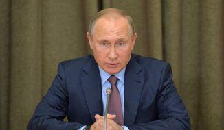 Russian President Vladimir Putin heads a meeting on military industry issues in the Black Sea resort of Sochi, Russia, Tuesday, Nov. 15, 2016. (Alexei Druzhinin/Sputnik, Kremlin Pool Photo via AP)