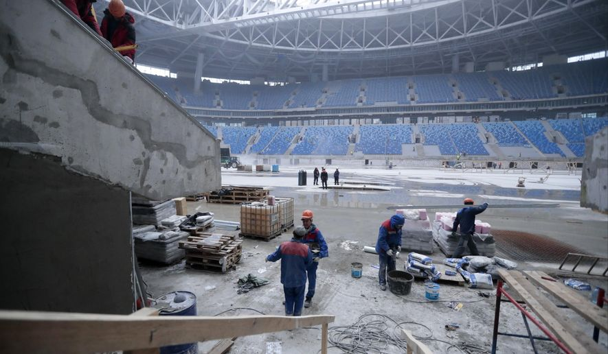 FILE In this Monday, Oct. 3, 2016 file photo workers are busy at the soccer stadium, which is under construction on Krestovsky Island, in St. Petersburg, Russia. A Russian official says a North Korean man has died while working on a stadium for the 2018 World Cup. (AP Photo/Dmitri Lovetsky, file)