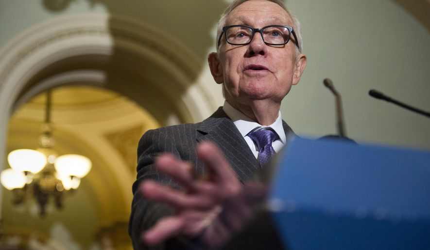 Outgoing Senate Democratic leader Harry Reid of Nev., speaks with reporters along with Nevada's newly elected Congressional Democrats on Capitol Hill in Washington, Monday, Nov. 14, 2016. (AP Photo/Cliff Owen)