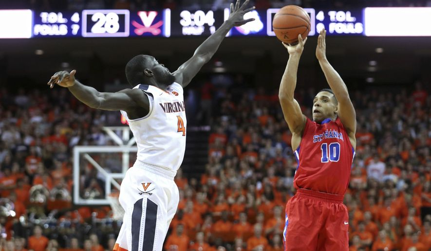 St. Francis (N.Y.) guard Glenn Sanabria (10) shoots over Virginia guard Marial Shayok (4) during the first half of an NCAA college basketball game on Tuesday, Nov. 15, 2016 in Charlottesville, Va. (AP Photo/Ryan M. Kelly)