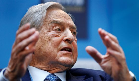 "George Soros, chairman of Soros Fund Management, speaks during a forum ""Charting A New Growth Path for the Euro Zone"" at the IMF/World Bank annual meetings in Washington, Saturday, Sept. 24, 2011. (Associated Press) ** FILE **"