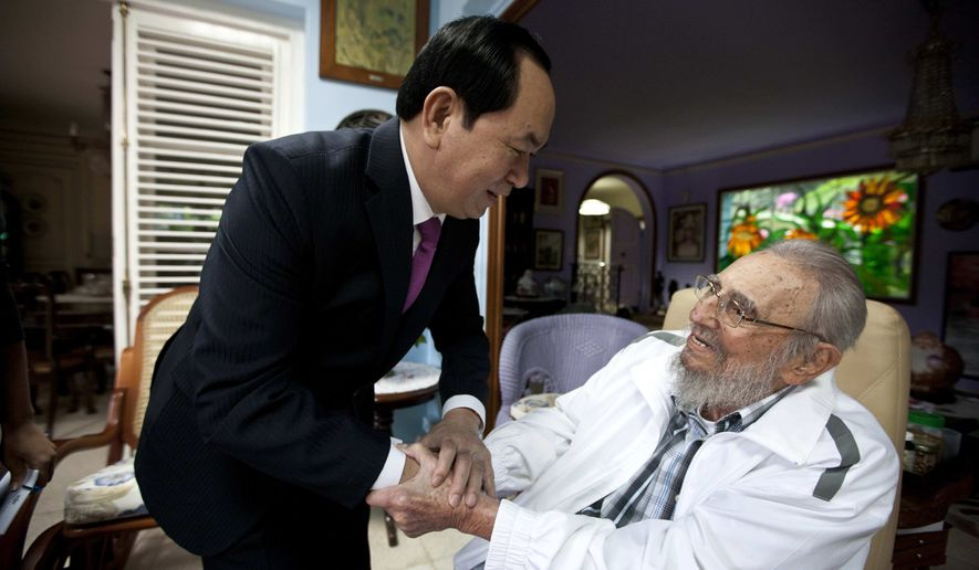 Cuba's former leader Fidel Castro, right, shakes hands with Vietnamese President Tran Dai Quang, left, in Havana, Cuba, Tuesday, Nov. 15, 2016. Quang is on a two-day official visit to Cuba. (AP Photo/Alex Castro)