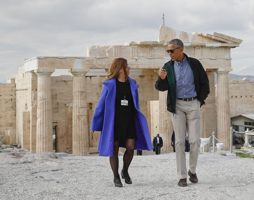 U.S. President Barack Obama tours Acropolis with Dr. Eleni Banou, left, director of Ephorate of Antiquities for Athens, Ministry of Culture, Wednesday, Nov. 16, 2016 in Athens. (AP Photo/Pablo Martinez Monsivais)
